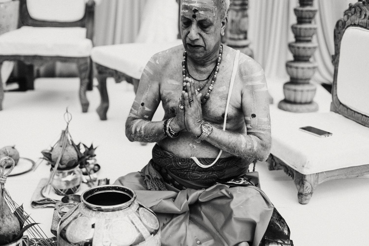 hindu preiest prays during hindu ceremony