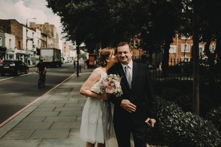 russian bride kisses father before wedding ceremony in islington wedding