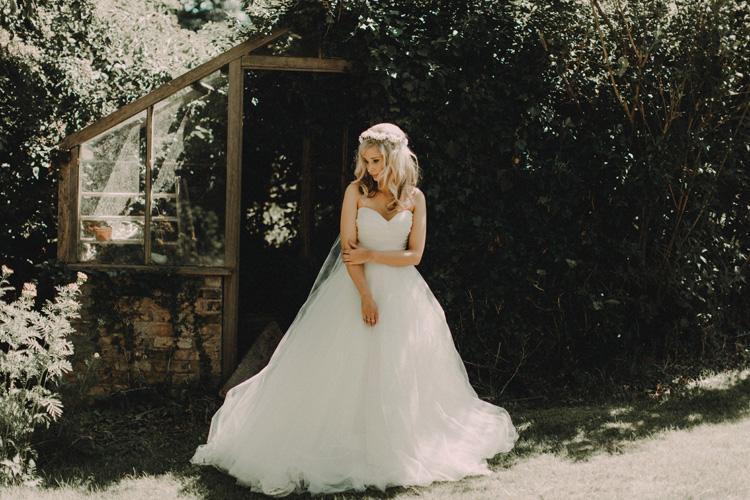 boho bride stands in garden ready for chesham wedding