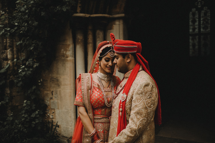 asian bride and groom hold each other in intimate southampton wedding