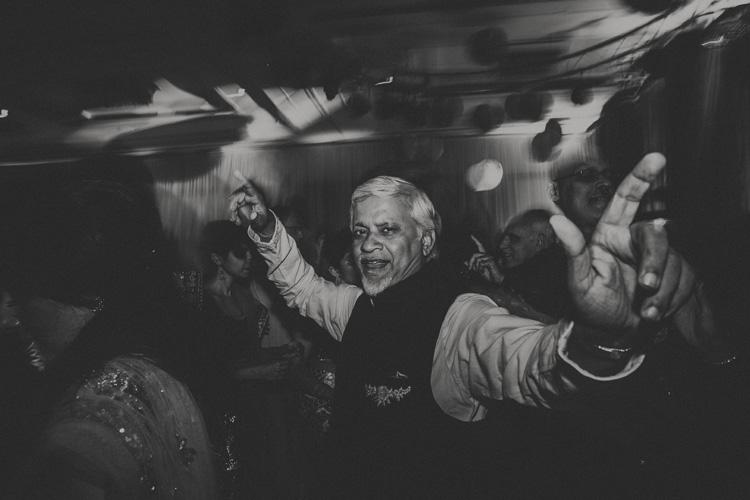 uncle dancing at hindu wedding reception in southampton wedding