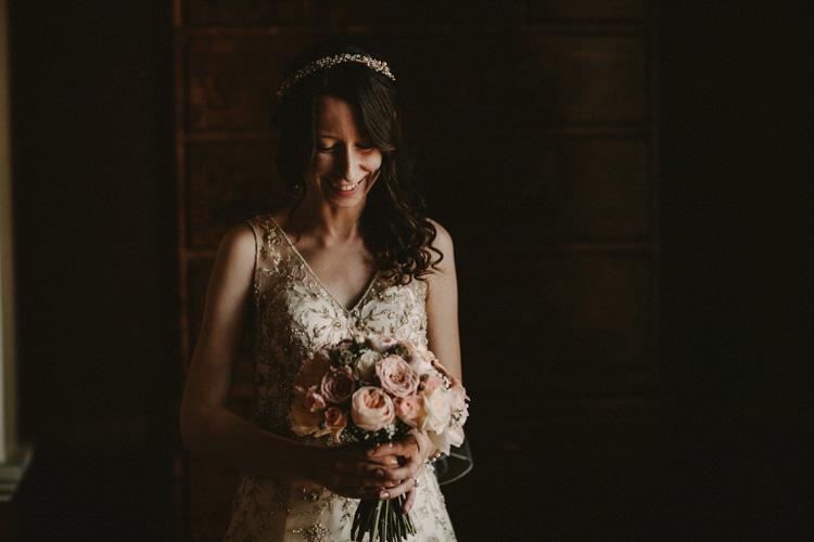 vintage bride laughs before wedding ceremony in quex park wedding