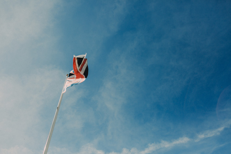 union jack flag blowing in the wind at quex park wedding