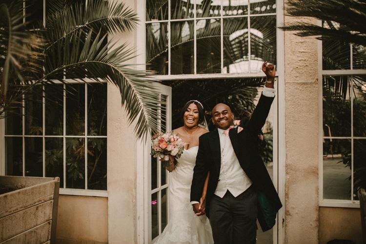 bride and groom processional into syon park wedding reception