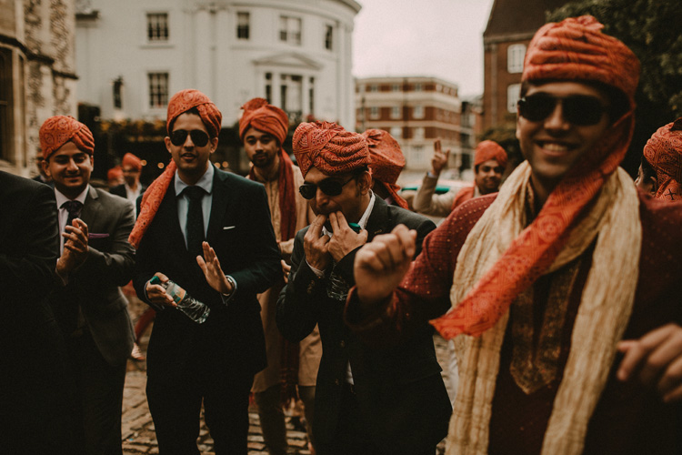 grooms family parade in southampton streets in hindu wedding recessional