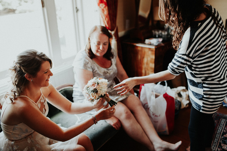 bride gives braidsmaid vintage bouquet in quex park wedding