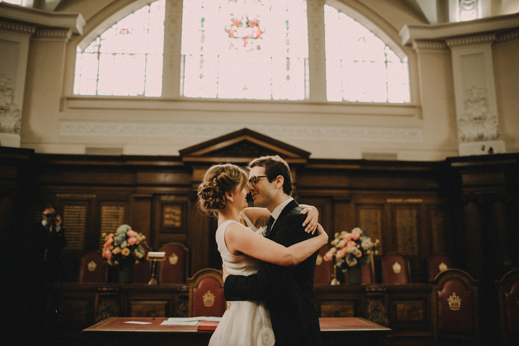 russian bride and french groom kiss during london civil wedding