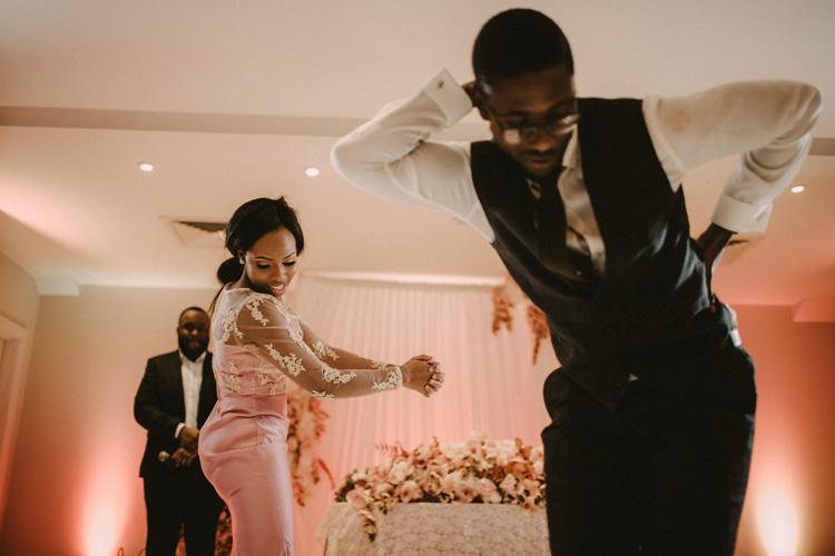 bridesmaid and groomsmen dance in froyle park wedding reception