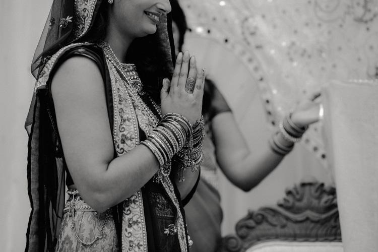 bride pays respect to hindu god in london hindu wedding
