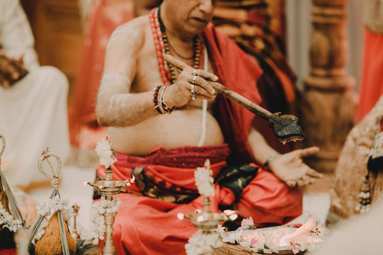 hindu priest during hindu ceremony in london hindu wedding