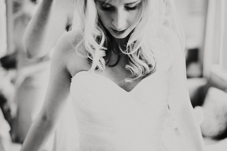 boho bride is laced into her wedding dress in chesham wedding