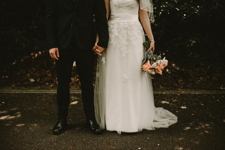 bride and groom hold hands in surrey wedding