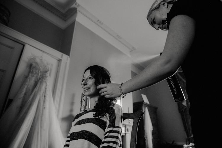 vintage bride getting hair done in quex park wedding