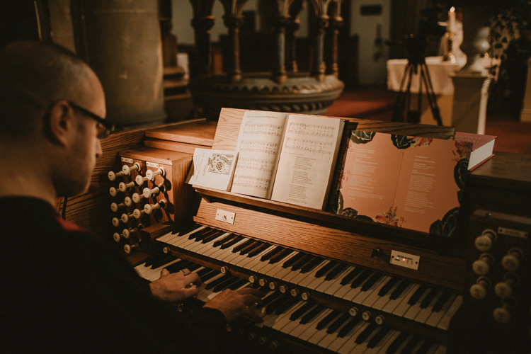 pianist plays during ceremony in london wedding