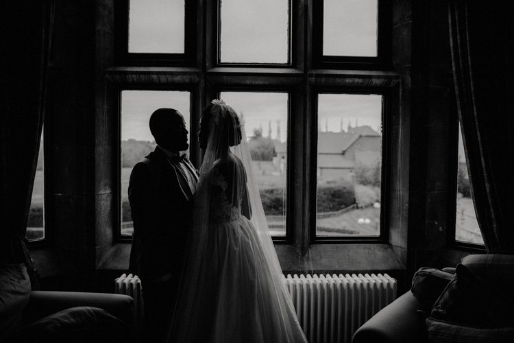 bride and groom share intimate moment in froyle park wedding
