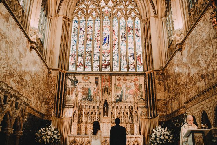 bride and groom at altar during farm street church wedding