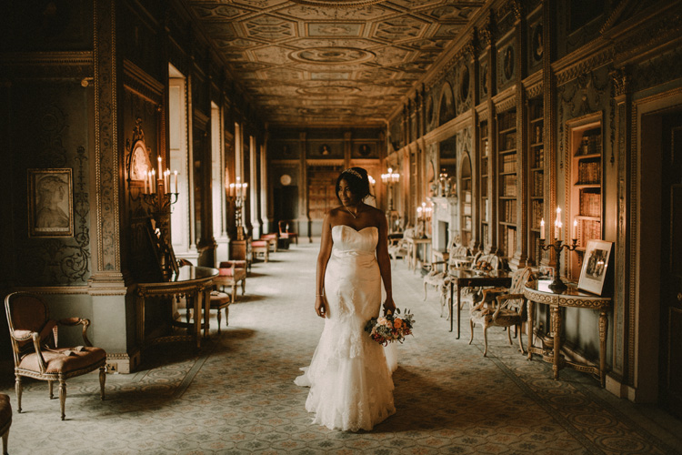 modern bride stands with bouquet at syon park