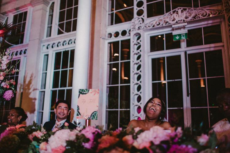 modern bride laughs during best man speech at syon park