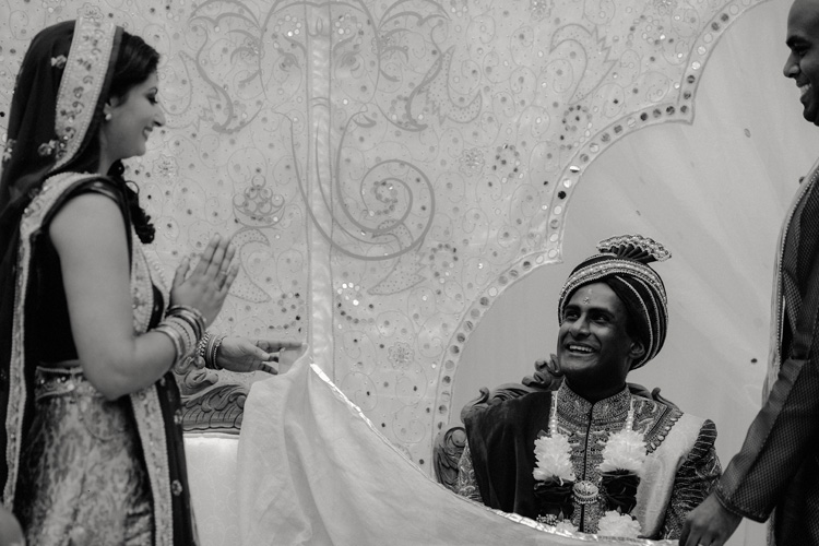 bride is unveiled to groom during hindu wedding ceremony