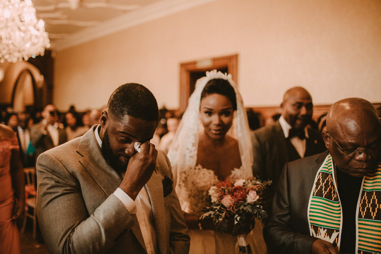 groom sheds a tear during froyle park wedding