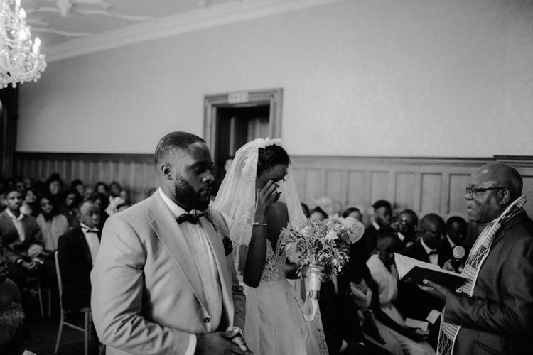 bride sheds a tear during ceremony at froyle park