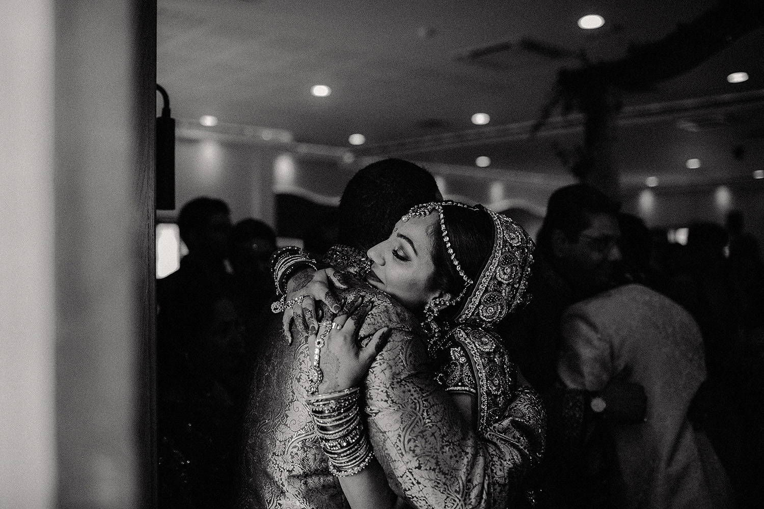 Copy of Copy of Copy of Copy of Copy of asian bride hugs brother after London hindu ceremony