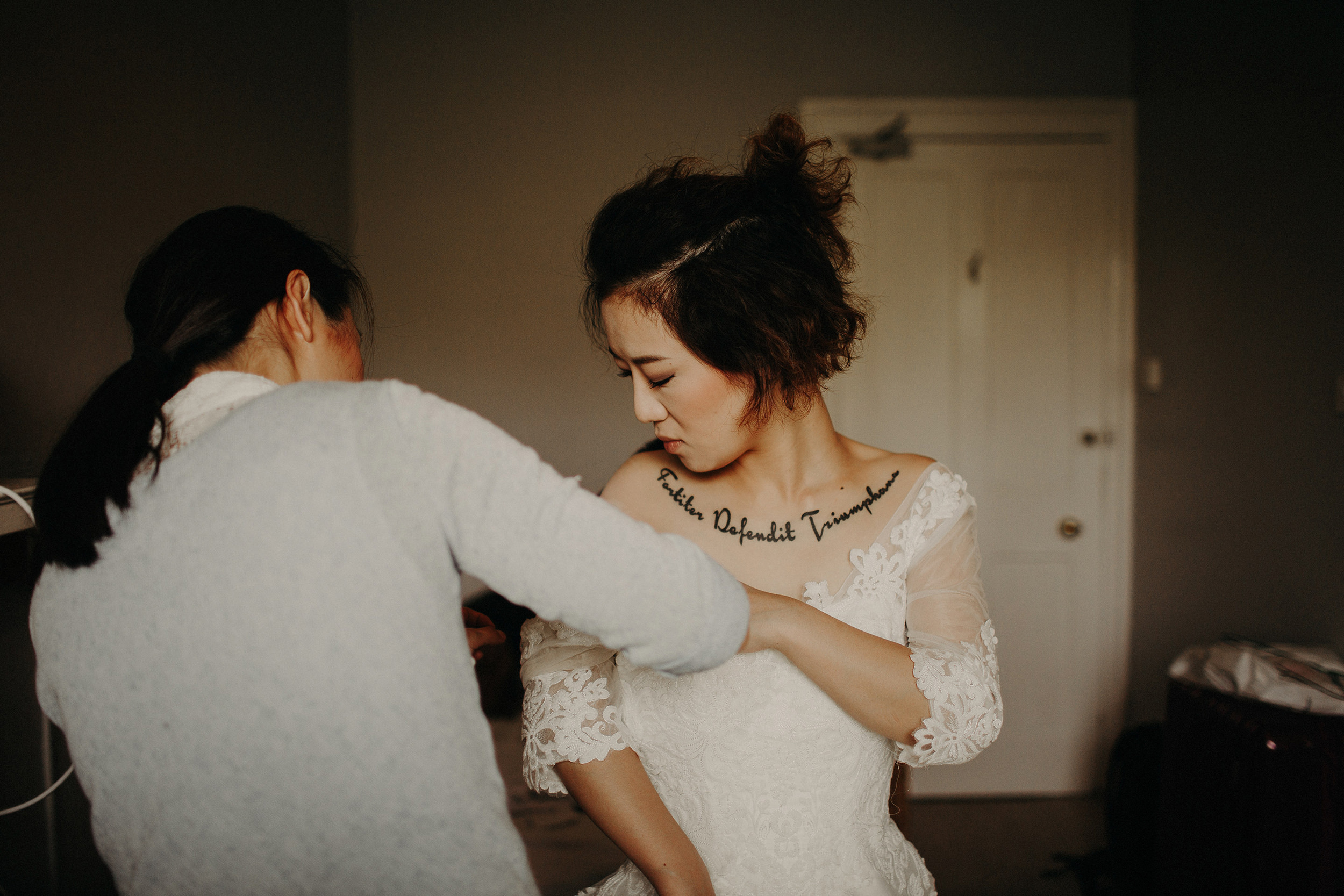 tattooed bride getting ready during edinburgh elopement