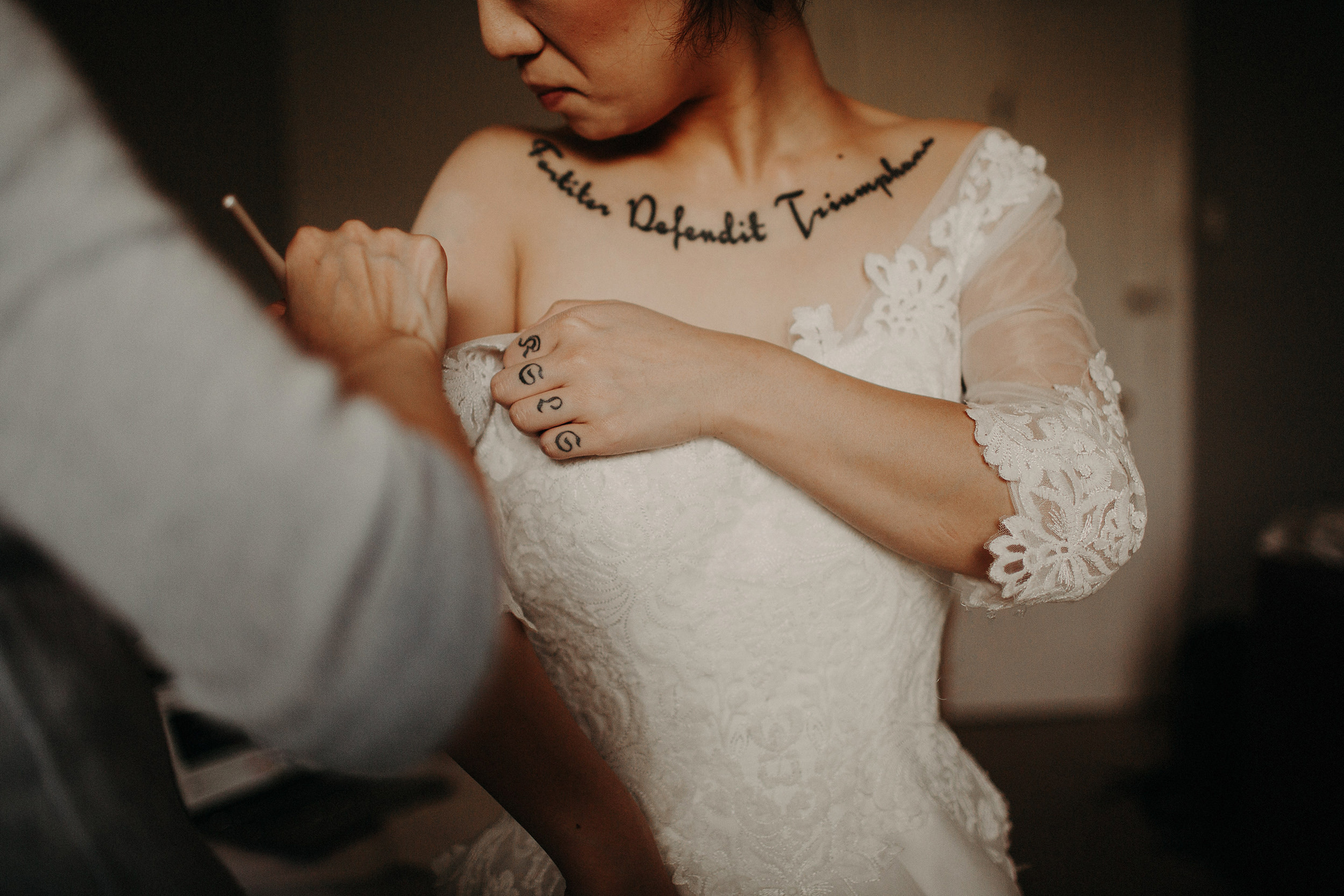 tattooed bride getting ready during isle of skye elopement
