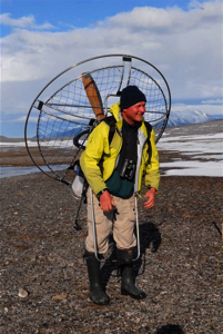 Dr. Olivier Gilg plays paraglider pilot on land.