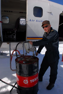 Arnar, one of the two pilots, refuels the plane from the drum they had left behind the day before.