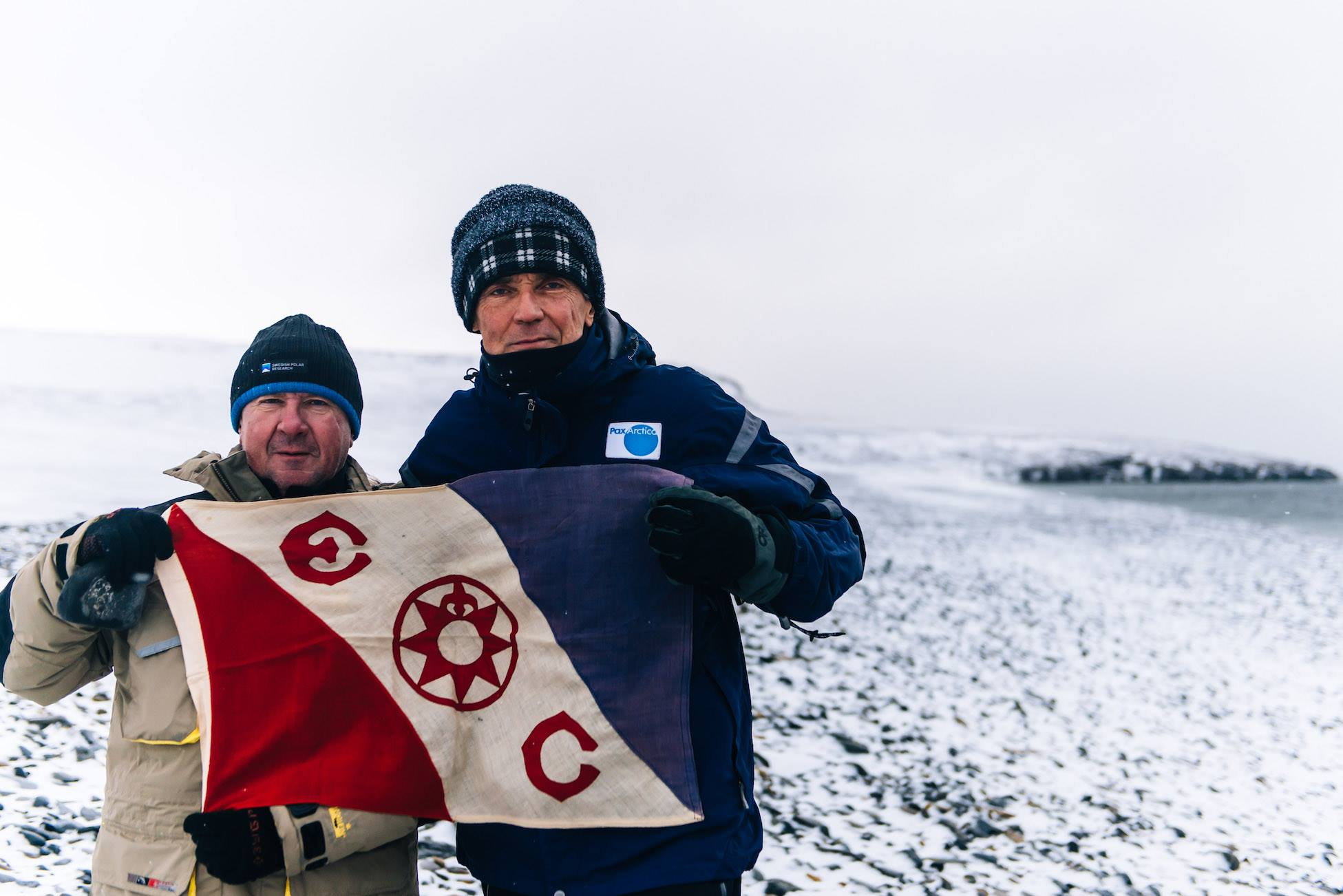 Luc (right) with Prof. Alexei Tikhonov after a nature samples/arctifacts collecting session on Bennett Island. The Explorers Club flag!