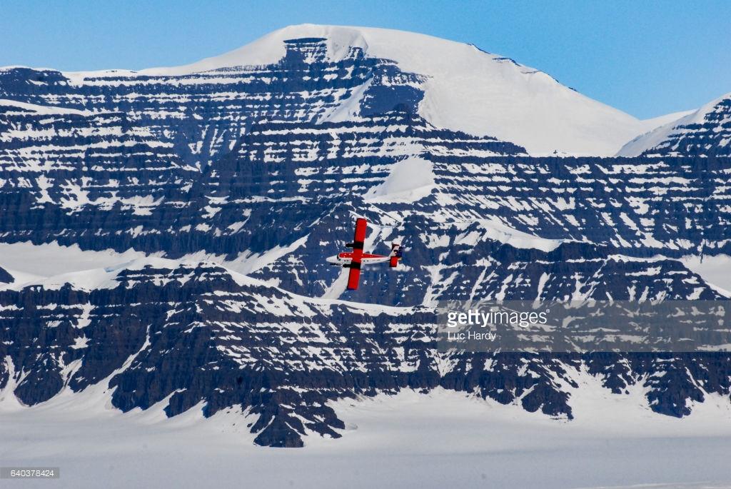 Red airplane landing in Greenland.jpg