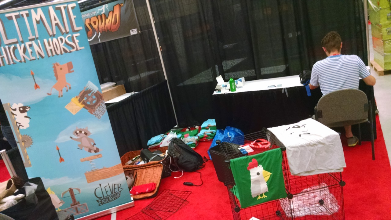 Setting up our booth, not quite as large as some others...