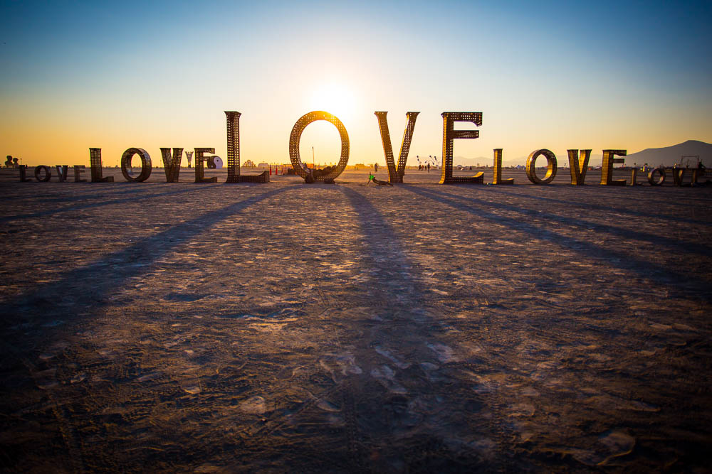 """Love"" installation at sunrise, Black Rock City 2014"