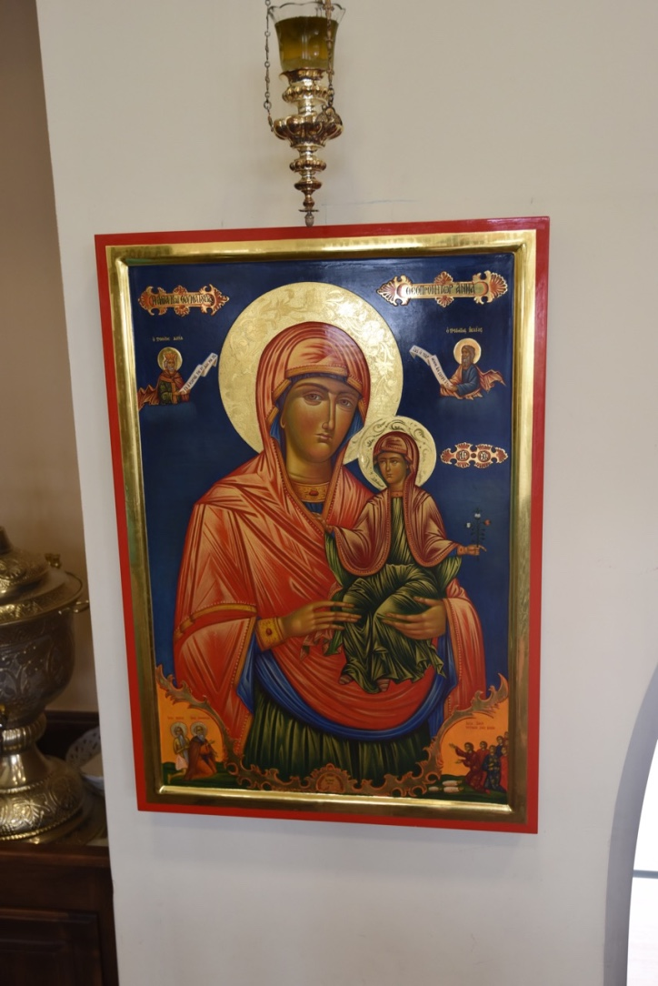 The copy of the miracle working icon hanging at our Church, prepared by the Theophileon Brotherhood at the Skete of St. Anna, Mount Athos