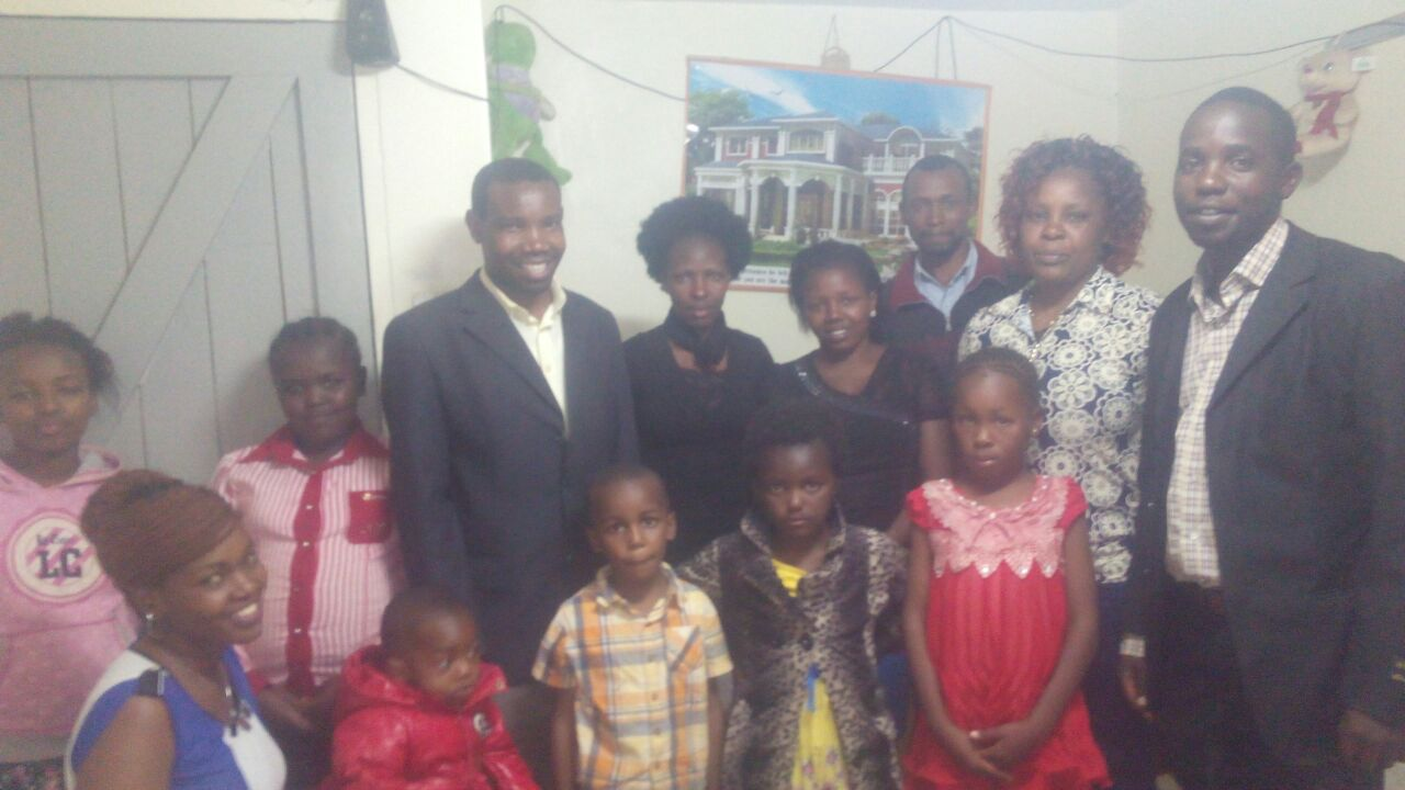 Fr. Cosmas with members of the community of St. Anne