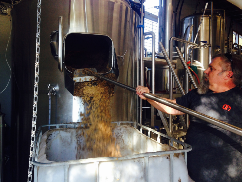 Scott graining out the spent grain from our brew.