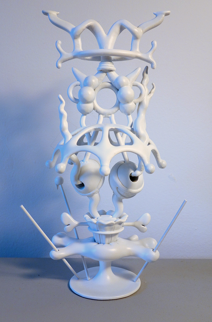 The final piece was printed in resin then painted, with two pieces comprising the main body and three removable sticks protruding from the base.