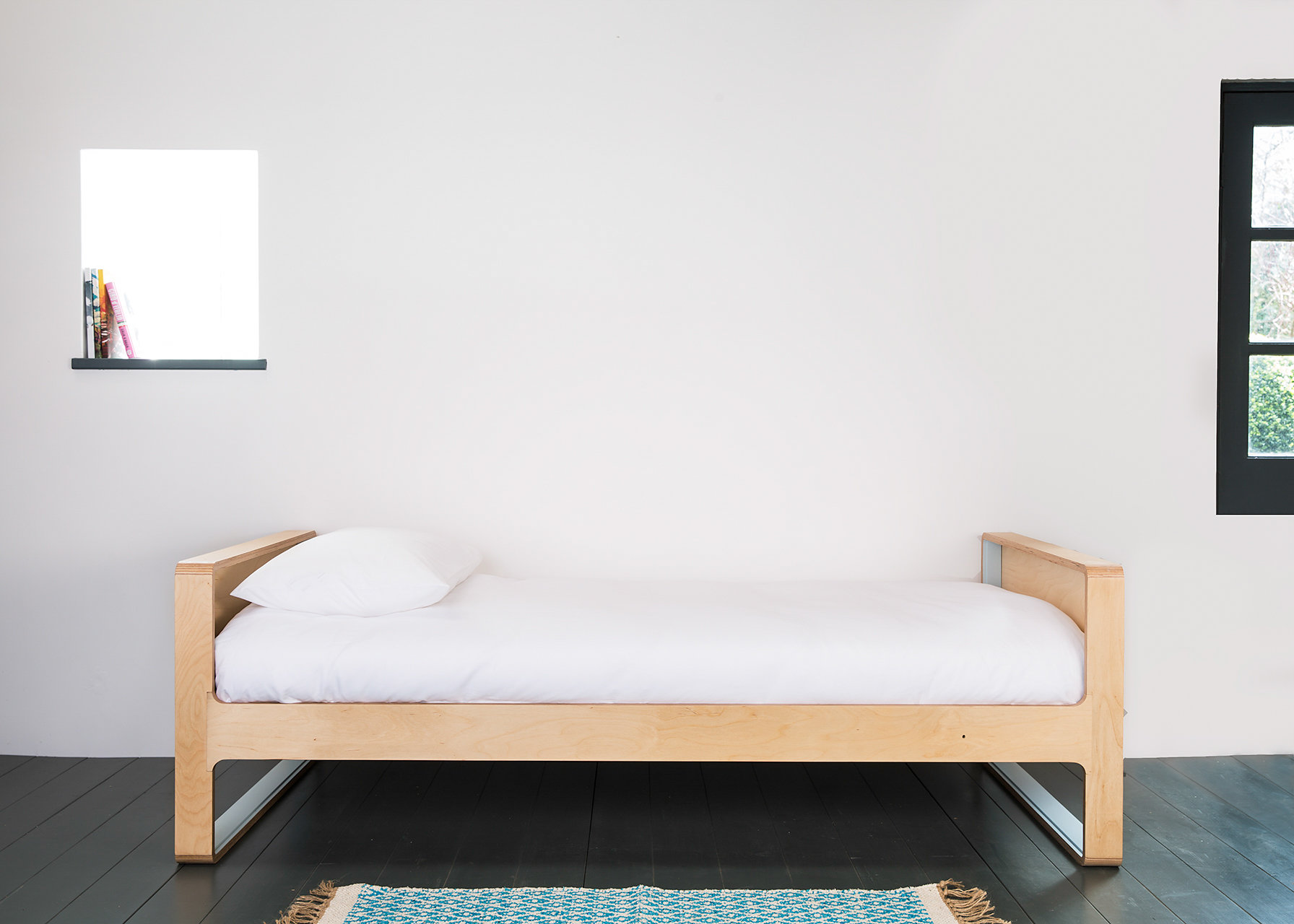 Skandi style full size single bed with sprung beech slats. This bed can also be made to take a 2000mm long mattress.  material: birch ply  dimensions: l 2020  h 1600  d 980    to fit 900 x 1900 matress  price: from £850