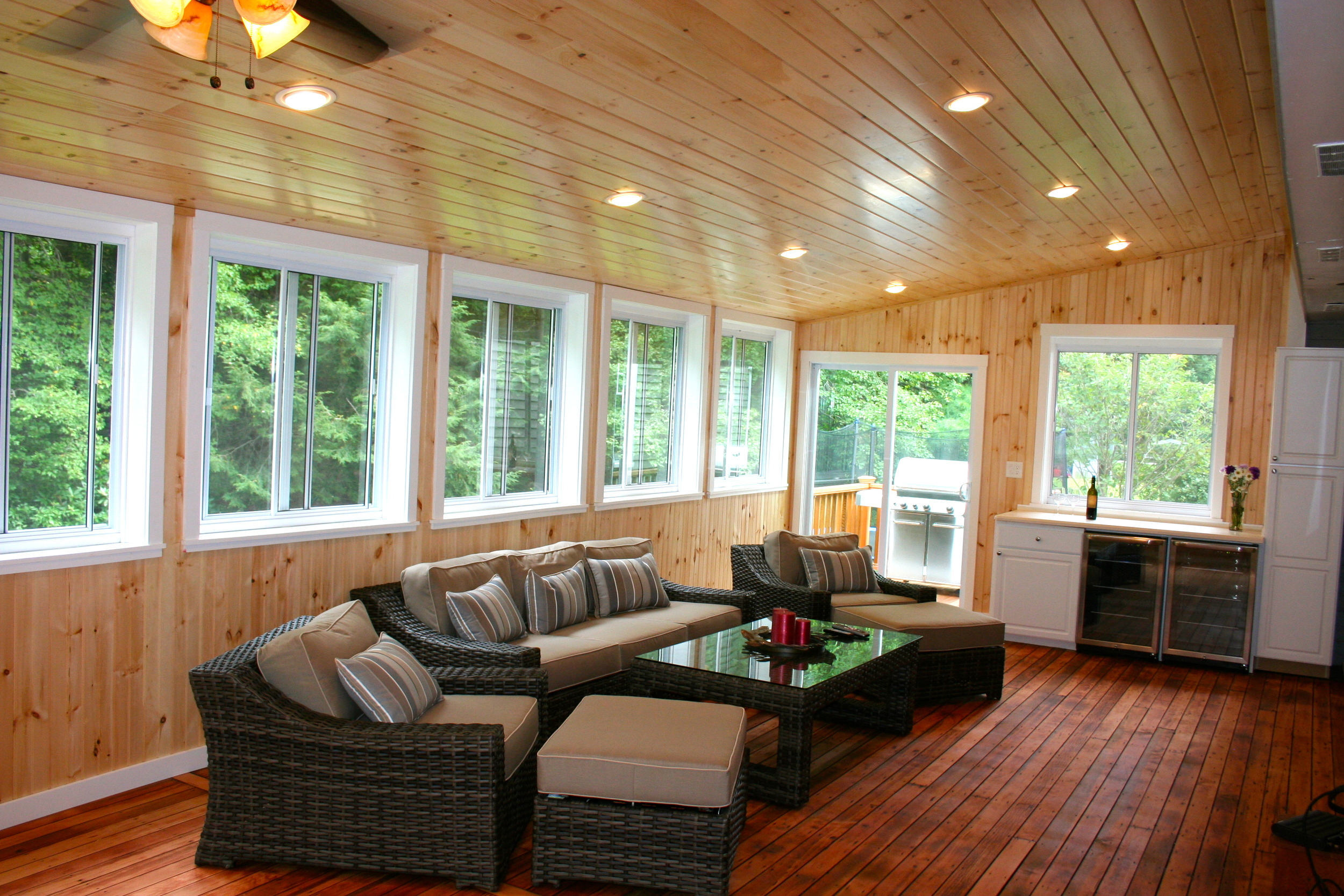 An old screen porch becomes a three-season room.