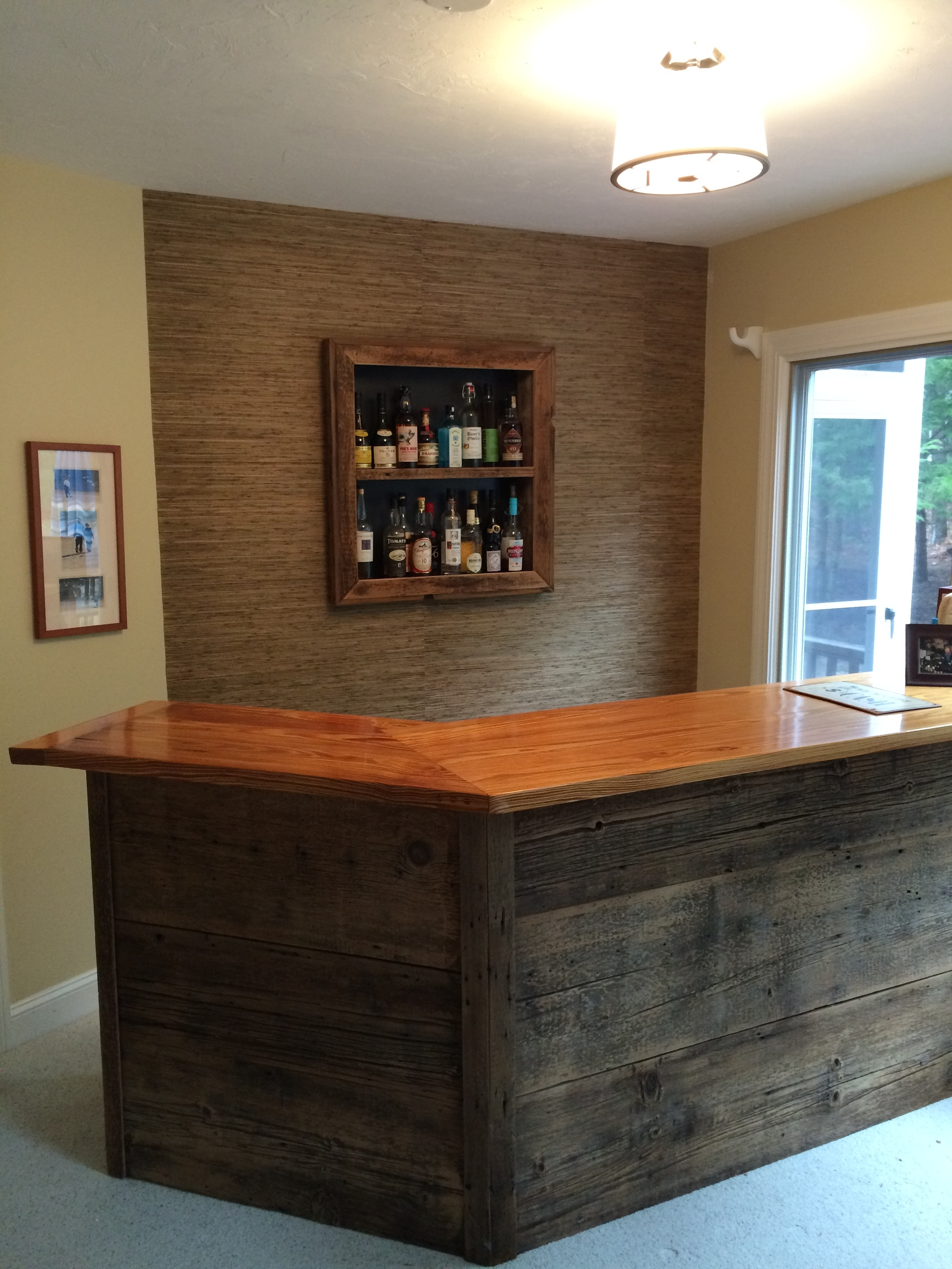 A custom bar with recessed shelving.