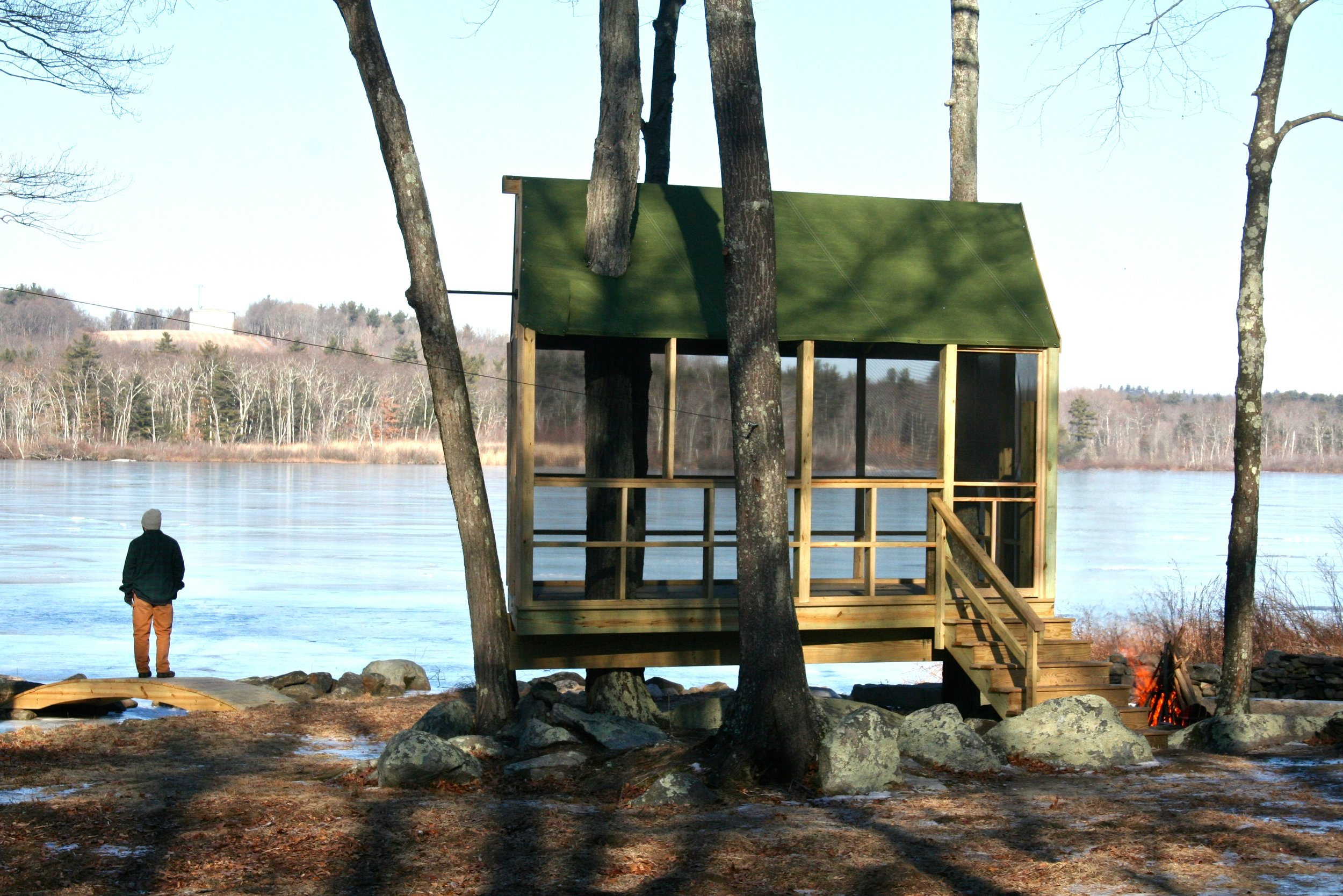 A roofed and screened-in treehouse is a fun and comfortable place to enjoy the pond!
