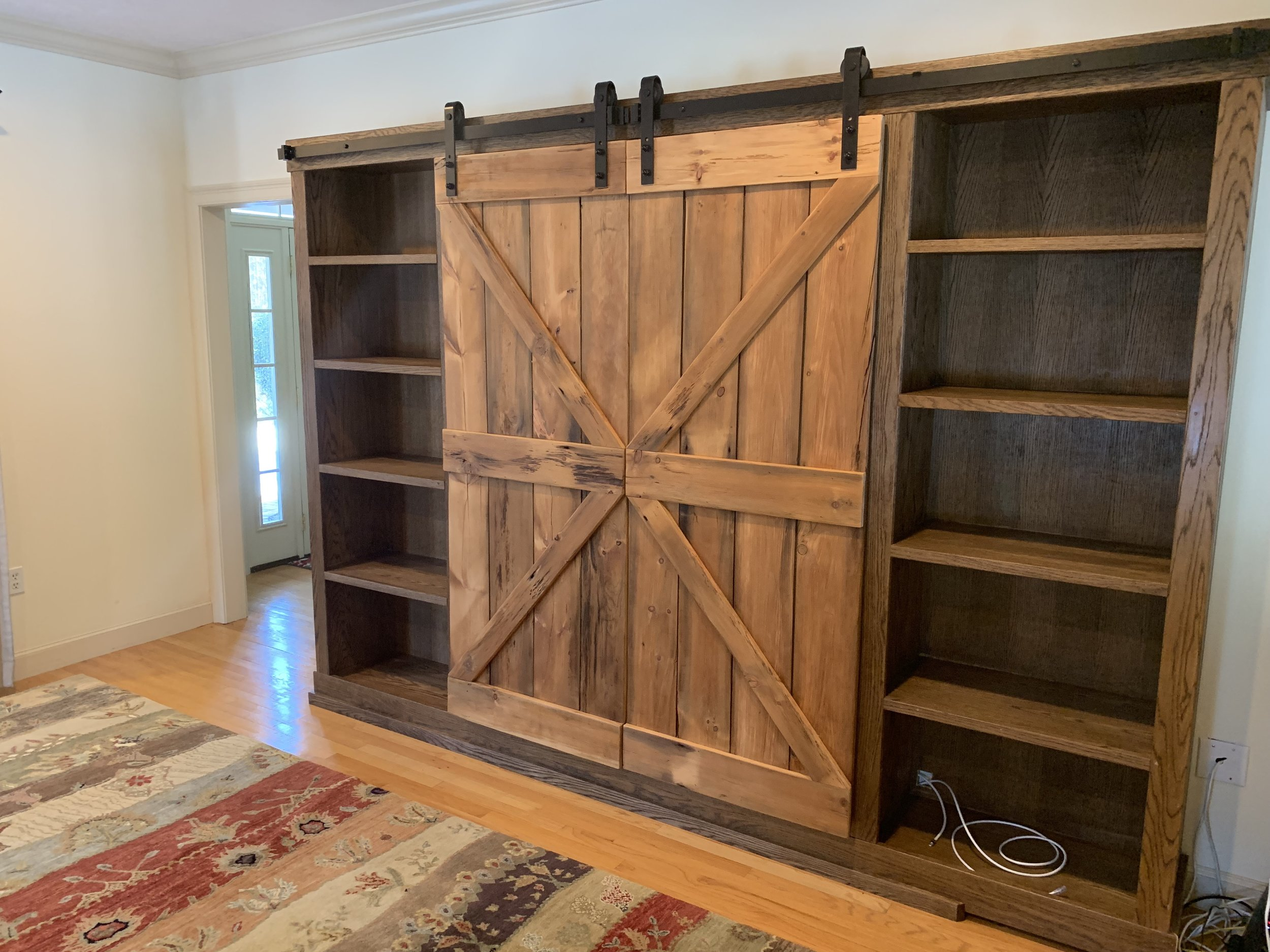 Custom wall unit with reclaimed sliding barn doors.