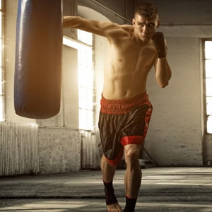 guy-punching-bag-malibu-boxing-heavy-bag.jpg