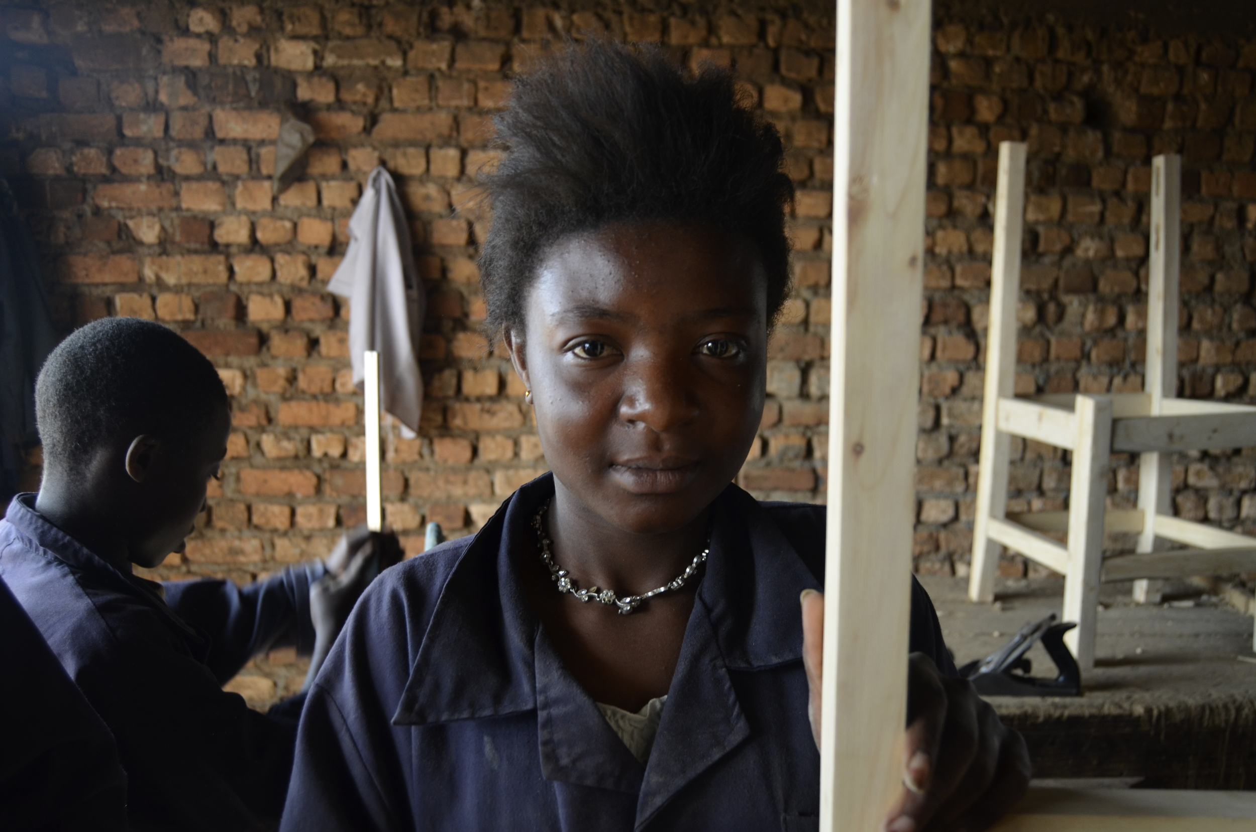Woodworking student at Let Africa Live in classroom at training center in Bukavu, city in the South Kivu province of the DRC.
