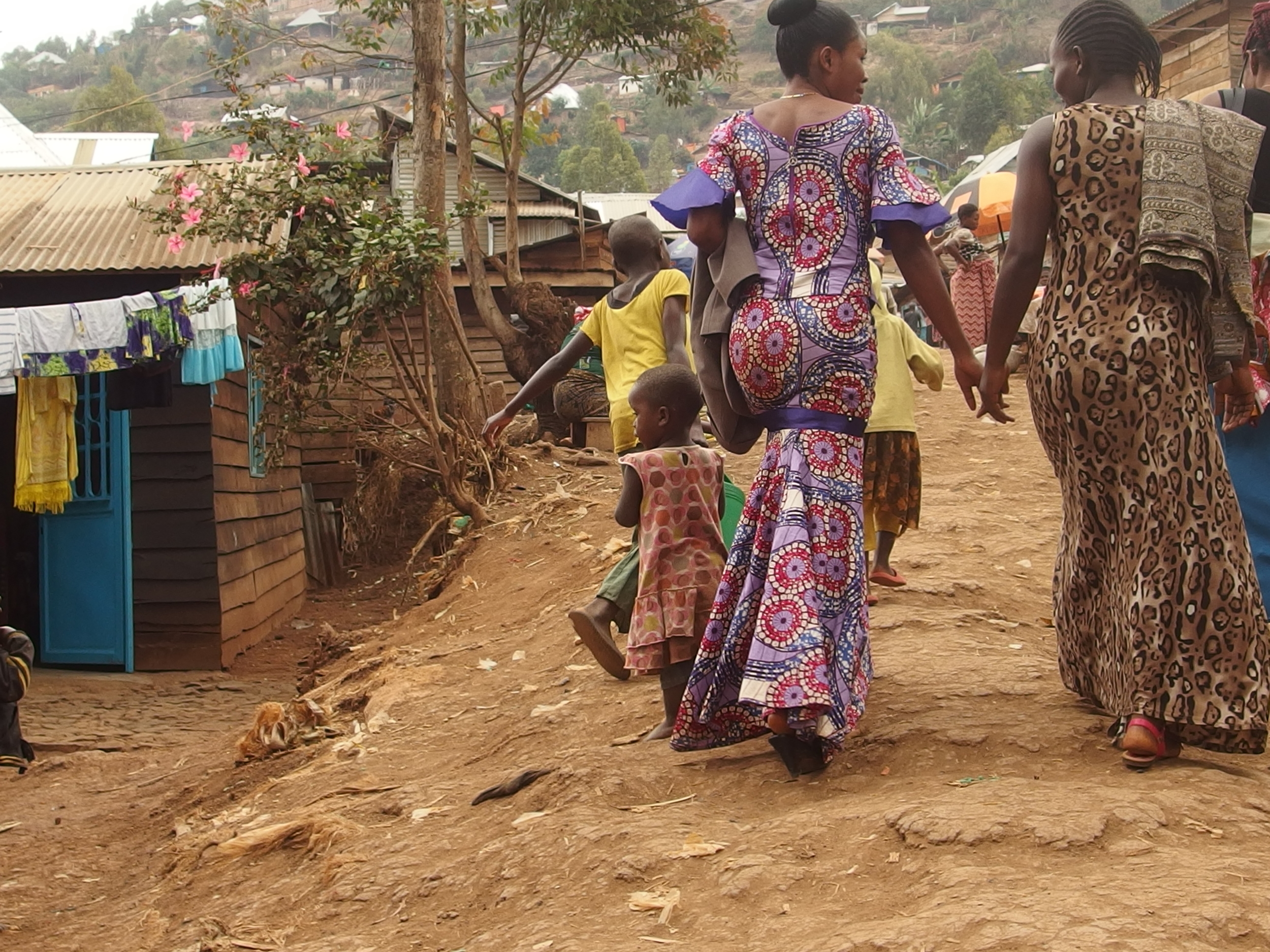 Walking with two of the sewing machine recipients to their workshop. They work together and have already started training three more women from their community on their machines.