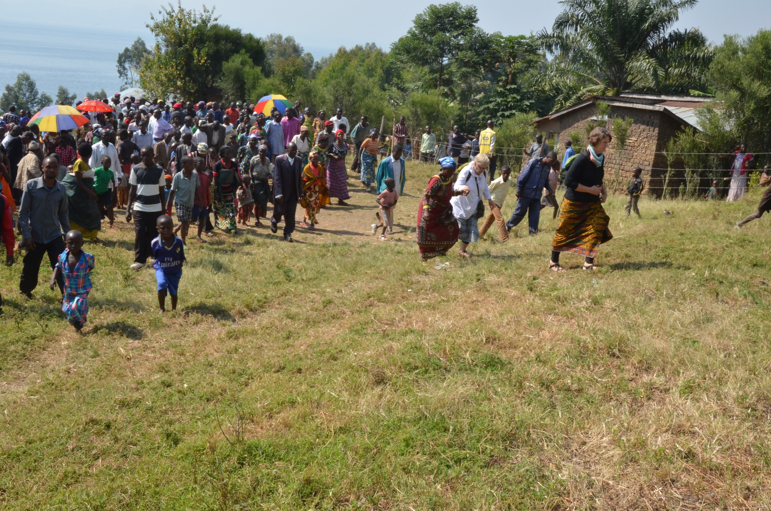 Walking with the community on the land that has been purchased for a future health center on Idjwi Island
