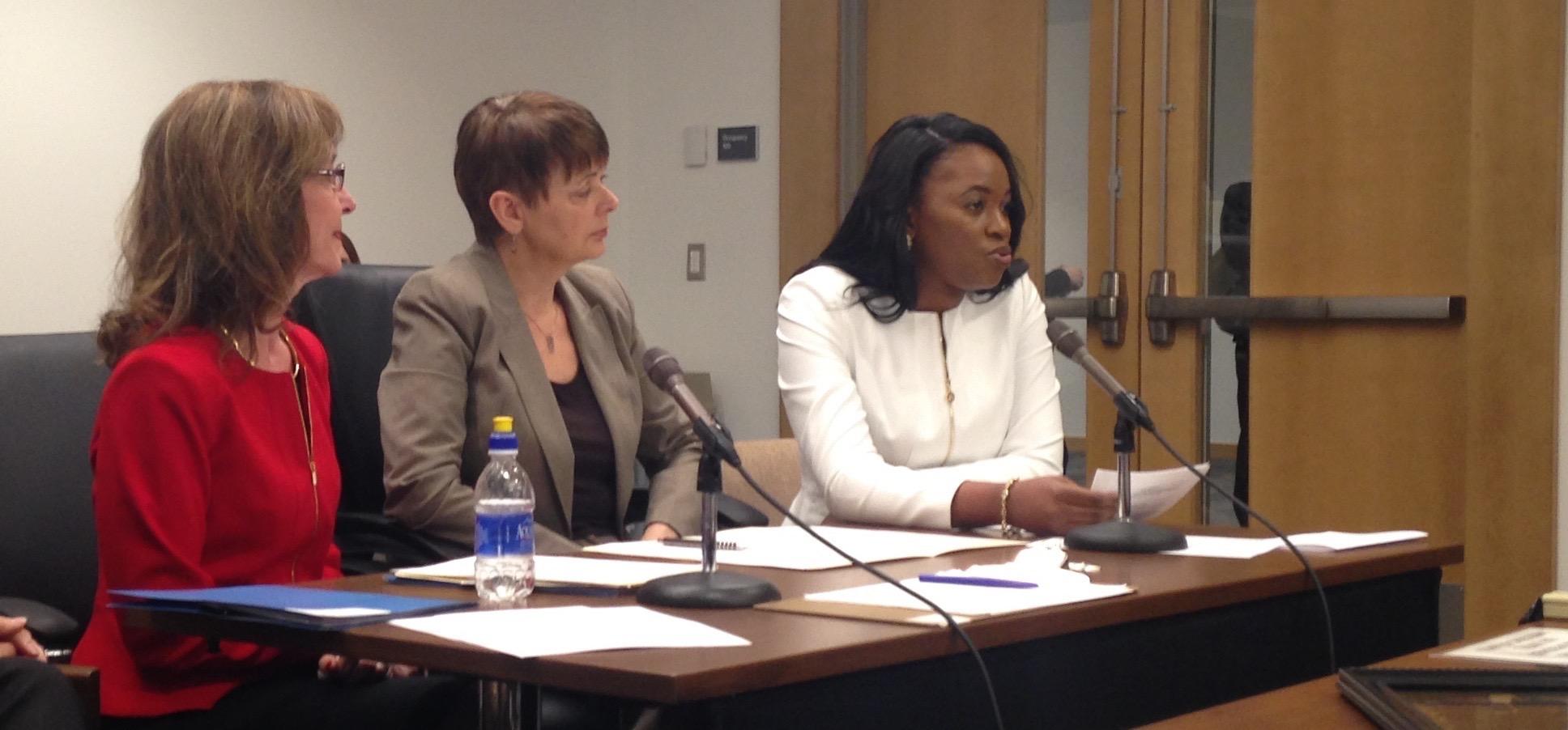 Dr. Edwige Mubonzi testifying with Dr. Ellen Kennedy (far left) and Senator Sandra Pappas (Middle)
