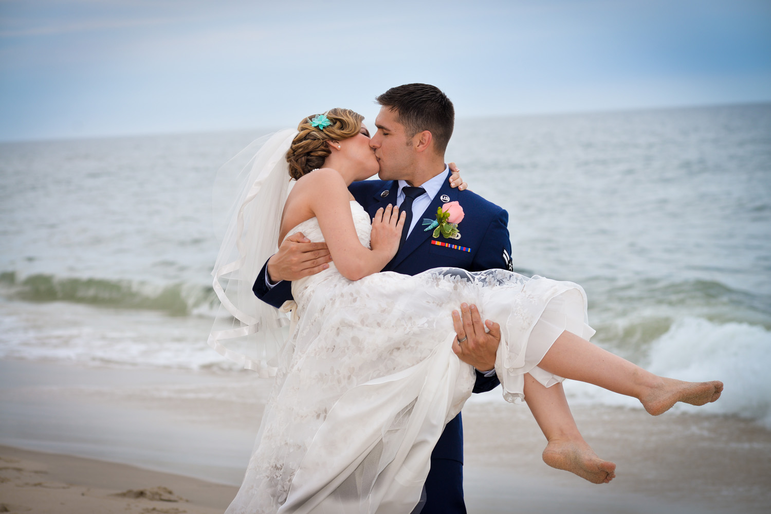 Wedding Day embrace on the beach / Meyer Photography