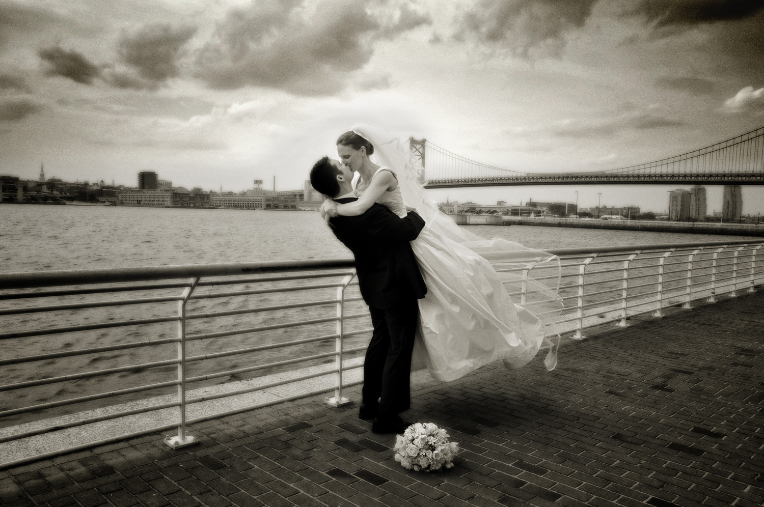 bride and groom at Camden, New Jersey riverfront / Meyer Photography